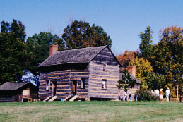"""Reconstructed log cabin similar to one young James K. Polk lived in at the Pres. James K. Polk State Historic Site near Pineville."" Image courtesy of the James Polk NC Historic Site."
