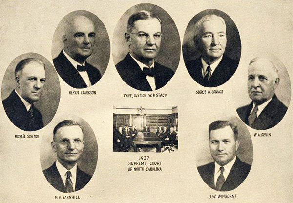 The Supreme Court of North Carolina for 1937: W. P. Stacy, M. V. Barnhill, Michael Schenck, Heriot Clarkson, George W. Connor, W. A. Devin, and J. W. Winborne. Image from the North Carolina Museum of History.