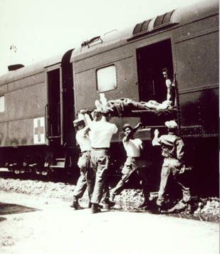 """A patient is loaded into an Army hospital car."" Photo owned by NC Transportation Museum. http://www.nctrans.org/"