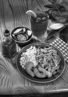 A traditional North Carolina barbecue meal, with pulled pork, coleslaw, hush puppies, fried squash, hot sauce, and iced tea. Photograph courtesy of North Carolina Division of Tourism, Film, and Sports Development.