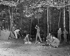 Boy scouts team of Walters Plant, no date (c.1960), location unknown, showing Boy Scouts chopping wood and making camp in the woods. From Carolina Power and Light (CP&L) Photograph Collection (Ph.C.68), North Carolina State Archives, call #:  PhC68_1_508_3.