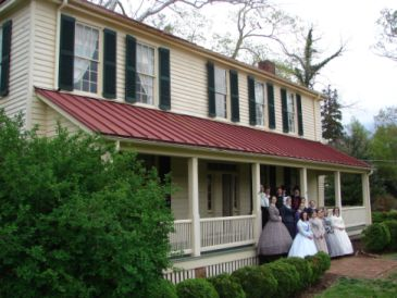 Burwell School with reenactors gathered for a family photo on the porch. Image courtesy of Burwell School Historic Site.