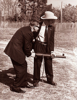 "Governor Terry Sanford and David Marshall ""Carbine"" Williams with a machine gun, c.1971. From the General Negative Collection, North Carolina State Archives, call #:  N_71_11_172 , Raleigh, NC."