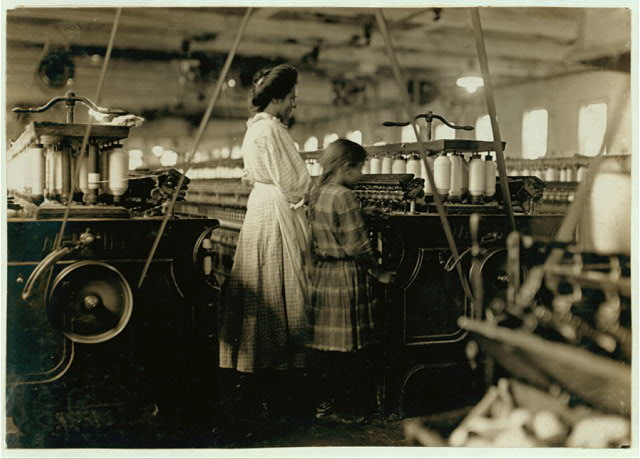 Lewis Hine photo of a small girl working in a Newton Cotton Mills, 1908