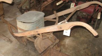 A seed planter made by Cole Manufacturing Company, 1920-1940. Image courtesy of North Carolina Museum of History.