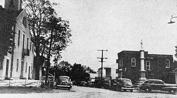 Street scene, Gatesville, NC, Courthouse and Confederate Monument (from State mag, 25 Sept 1948, p.14). From General Negative Collection, North Carolina State Archives, call #: N_97_7_150, Raleigh, NC.