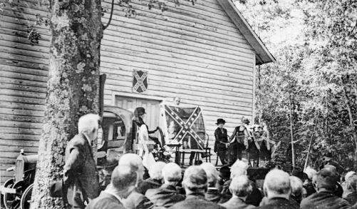 Confederate Memorial Day ceremony at Woodington Universalist Church in Lenoir County, 1920. The event was staged on the bed of a truck parked at the church entrance. North Carolina Collection, University of North Carolina at Chapel Hill Library.