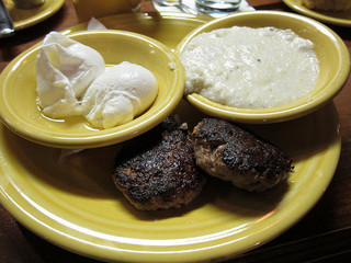 Country breakfast- eggs, grits, sausage, from Tupelo Honey Cafe, Asheville, North Carolina. Image courtesy of Flickr user Frivolous_accumulation.