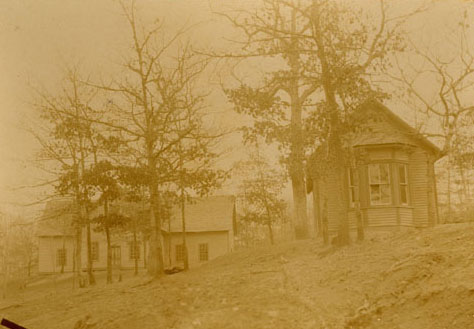 """The first two school buildings of Cullowhee High School, about 1891. The building on the left is the first schoolhouse. On the right is the Music and Art Building."" Image courtesy of Western Carolina Library Digital Collections."