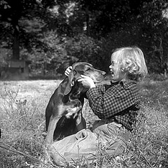 One of the Plott's Plott Hounds, 1952, with a Plott little girl. From Conservation and Development Department, Travel and Tourism Division Photo Files, North Carolina State Archives, call #: C&D 8623-E.