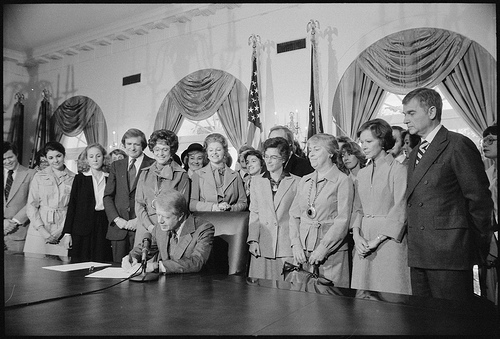 Photograph of Jimmy Carter Signing Extension of Equal Rights Amendment (ERA) Ratification, 10/20/1978