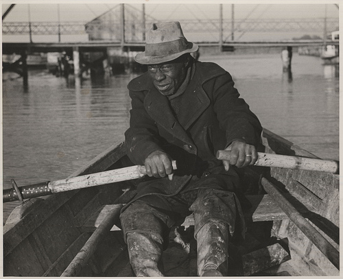 Unidentified man involved in anchor gill net fishing, Edenton, c.1939. From the Charles A. Farrell Photograph Collection, PhC.9, North Carolina State Archives, call #:  PhC9_2_56_4.
