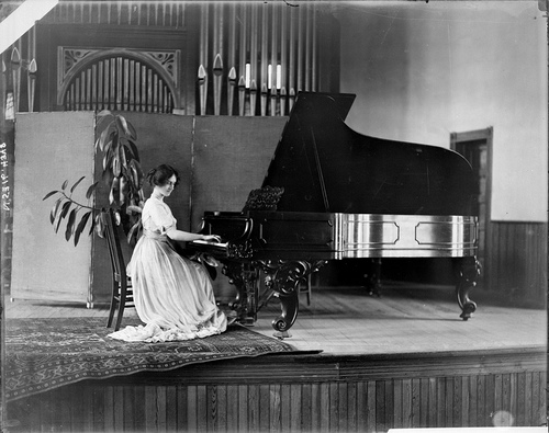 Girl playing piano at Peace College, circa 1910
