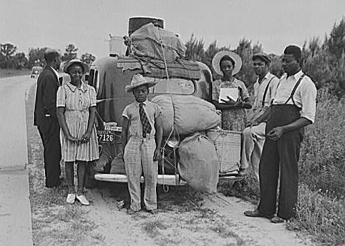 """Group of Florida migrants on their way to Cranberry, New Jersey, to pick potatoes. Near Shawboro, North Carolina."" Photograph created by Jack Delano. Image courtesy of Library of Congress."
