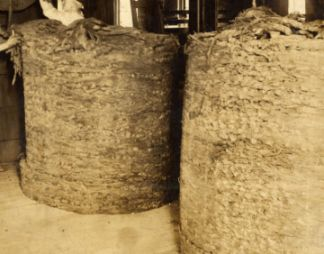 """Packing a Hogshead"". Image courtesy of Filson Historical Society via Smithsonian Institute."
