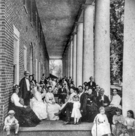 Guests on the portico of the hotel at Hot Springs, ca. 1873. Photograph by Rufus Morgan. North Carolina Collection, University of North Carolina at Chapel Hill Library.