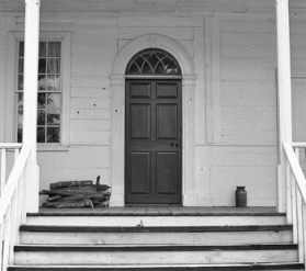 Back door of the Alston House. Note the bullet holes around the door. Courtesy of North Carolina Office of Archives and History, Raleigh.