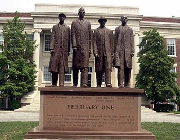 Photograph of statue of the A&T Four (Greensboro Four) on the campus of North Carolina A&T University, Greensboro, N.C., by cewatkin, 2000 Wikimedia Commons.  Used with Creative Commons CC-BY-SA 3.0 license.