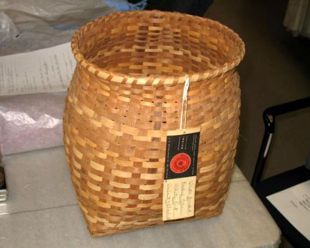 Photograph of handmade basket, made by Rachel Tooni, ca. 1973-1980, Qualla Arts and Crafts Board. Item H.2008.5.1 from the North Carolina Museum of History. Used courtesy of the North Carolina Dept. of Natural and Cultural Resources.
