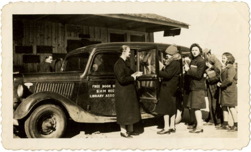 Beaufort Hyde Martin Regional Library Association bookmobile with librarians and patrons. February, 1942.