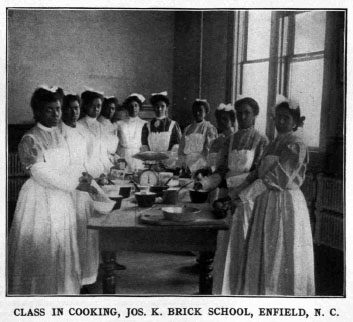 Image of cooking class at the Brick School, ca. 1910. From <i>Era of progress and promise, 1863-1910 : the religious, moral, and educational development of the American Negro since his emancipation</i>. The Clifton Conference. Boston: Priscilla Publishing Co., 1910. From the collection of the N.C. Government & Heritage Library.
