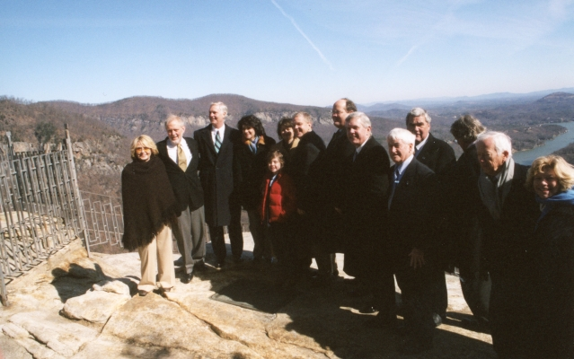 Governor Easley, Lucius and Todd Morse and family members, State Parks Director Lewis Ledford, and other dignitaries at the announcement of the State of North Carolina purchasing Chimney Rock Park from the Morse Family, January 2007. From the collection of North Carolina State Parks.