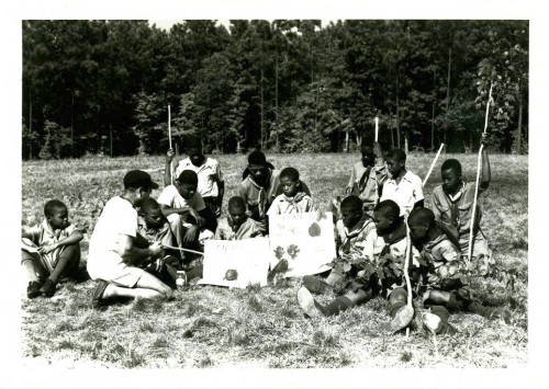 Boyscouts learning about native plants and animals at Crabtree Creek or Reedy Creek State Park, ca. 1940s to 1950s. Crabtree Creek had two park entrances during segregation. In 1950, the southern entrance at Reedy Creek and its surrounding 1,234 acres were split into a separate state park exclusively for African Americans. North Carolina State Parks Collection, NC Digital Collections.