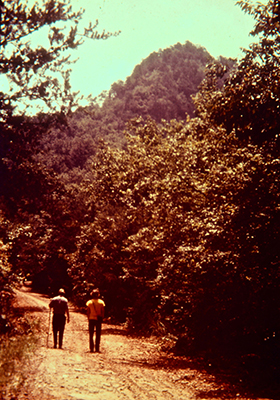 Photograph of hikers on trail at Crowders Mountain State Park, ca. 1975. From the collection of North Carolina State Parks.