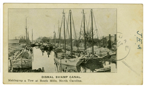 """Dismal Swamp Canal: Making-up a tow at South Mills, North Carolina."" Postcard ca. 1906, P. W. Melick Co. From the Durwood Barbour Collection of North Carolina Postcards, NC Collection Photographic Archives, Wilson Library, UNC-Chapel Hill."