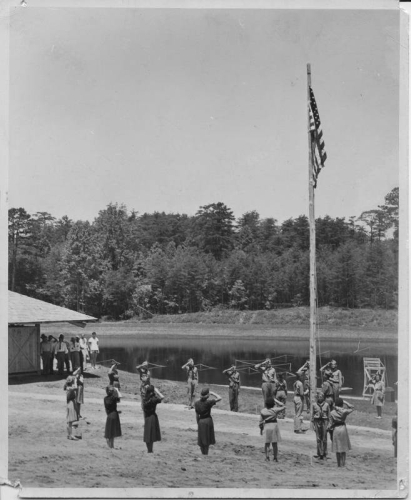 Scouts saluting the American Flag, grand opening of the community park in Mayodan,  N.C. on July 3, 1948. Today the site is Mayo River State Park. From the North Carolina State Parks Collection, NC Digital Collections.