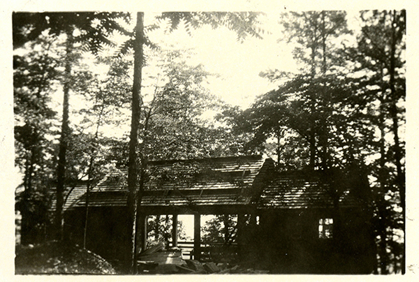 Photograph of picnic shelter at the top of Morrow Mountain, 1944. The shelter was built in the late 1930s by the Civilian Conservation Corps and is typical of the rustic style created by WPA projects of the New Deal era. From the State Parks Collection, NC Digital Collections.