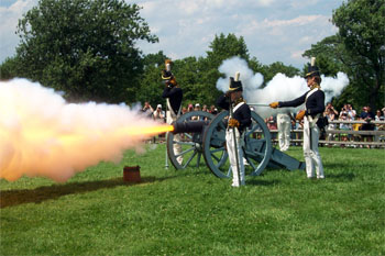 Photograph of re-enactment of firing a Howitzer at Fort McHenry, Baltimore, Maryland. From the Fort McHenry National Monument and Historic Shrine, National Park Service.