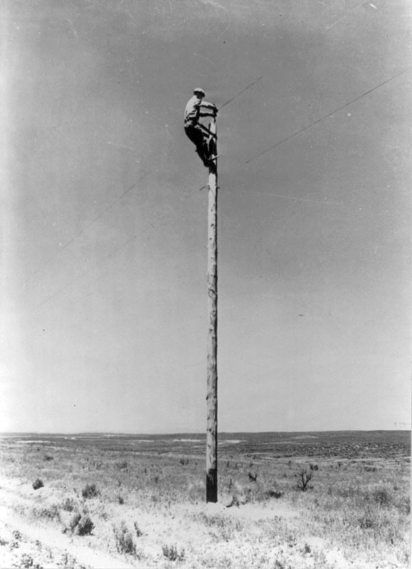 An REA lineman at work on the Great Plains