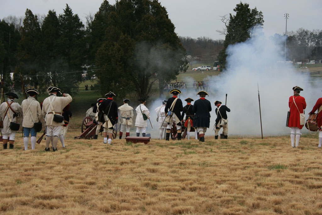Photographs from a reenactment tell the story of the Battle of Guilford Courthouse.