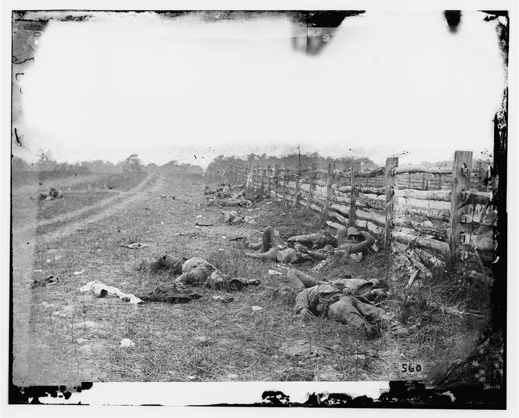 At Antietam, dead Confederate soldiers lie on the ground near a fence on the Hagerstown Road.