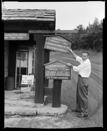 Changing the admission signs at Grandfather Mountain.