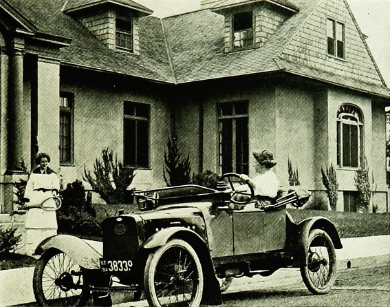 A car in front of a suburban home, 1915