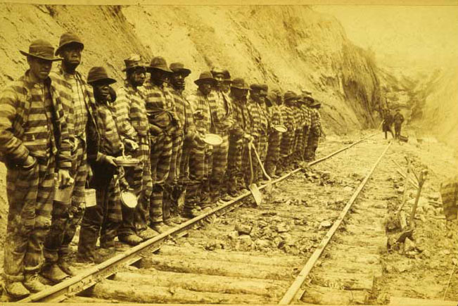 Convict labor working on a railroad