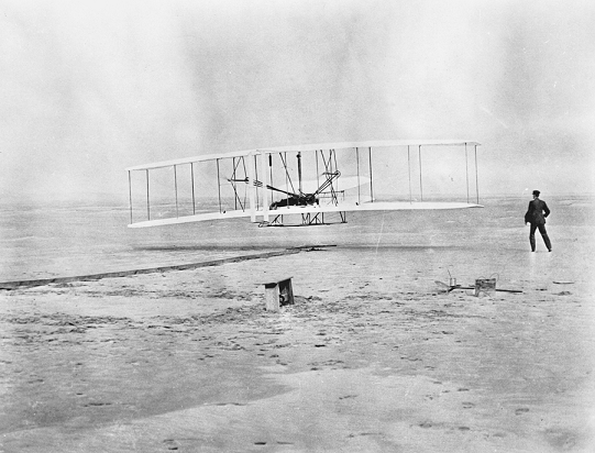 The first powered airplane flight at Kitty Hawk, 17 Dec. 1903. Courtesy of North Carolina Office of Archives and History, Raleigh.