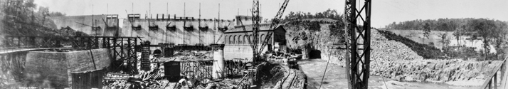 Construction of the Narrows Dam and powerhouse on the Yadkin River near Badin, a project of the Aluminum Company of America, 1917. North Carolina Collection, University of North Carolina at Chapel Hill Library.