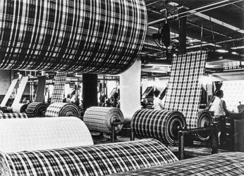 Inspectors examine newly woven fabric at the Burlington Industries mill in Mooresville, ca. 1960. North Carolina Collection, University of North Carolina at Chapel Hill Library.