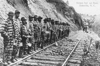 Chain gang working on a railroad near Asheville, 1915. Copied from a postcard. Courtesy of North Carolina Office of Archives and History, Raleigh. Call no. N_71_9_145.