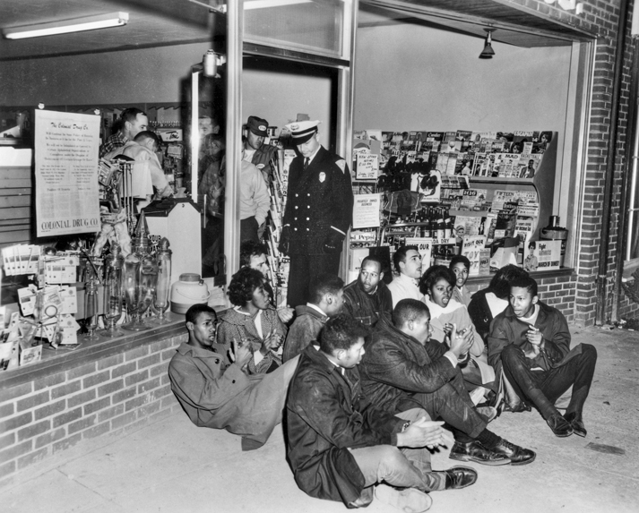 Demonstrators block the entrance to Colonial Drug Store in Chapel Hill in 1964 to protest its policy of serving whites only. North Carolina Collection, University of North Carolina at Chapel Hill Library.