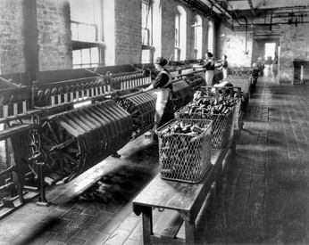 Reeling yarn at a cotton mill, ca. 1925. North Carolina Collection, University of North Carolina at Chapel Hill Library.