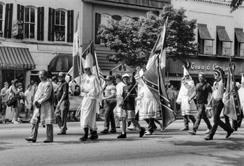 Ku Klux Klan demonstrators march down Franklin Street in Chapel Hill on 14 June 1987. Photograph by Jerry Cotten. North Carolina Collection, University of North Carolina at Chapel Hill Library.