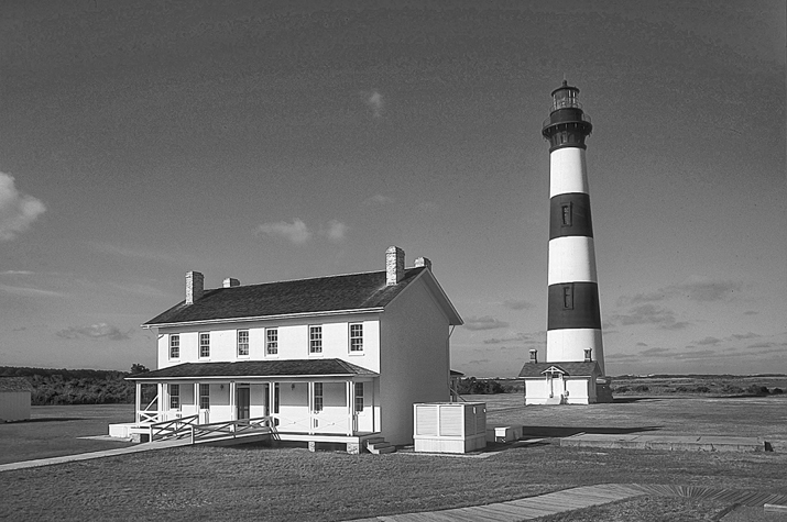 Bodie Island Lighthouse and keeper's quarters. Photograph courtesy of North Carolina Division of Tourism, Film, and Sports Development.