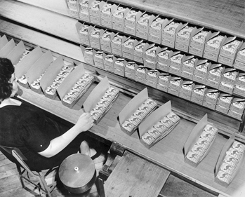 Inspecting cartons of Camel cigarettes at R. J. Reynolds Tobacco Company. North Carolina Collection, University of North Carolina at Chapel Hill Library.
