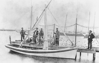 Fishermen at Manteo pose with their catch behind a Roanoke Island shad boat, ca. 1900. North Carolina Collection, University of North Carolina at Chapel Hill Library.