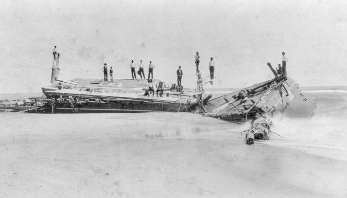 Local residents and perhaps crew members pose on the wreck of the Priscilla, which ran aground at Gull Shoal in Dare County in August 1899. North Carolina Collection, University of North Carolina at Chapel Hill Library.