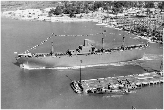 The SS Zebulon Baird Vance, a Liberty ship, heads out into the Cape Fear River after its launching in Wilmington, N.C., on December 6, 1941. The North Carolina Shipbuilding Company built many vessels like this one during World War II.